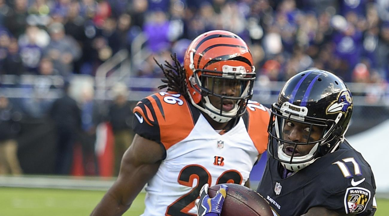 Baltimore Ravens wide receiver Mike Wallace (17) is forced out of bounds by Cincinnati Bengals cornerback Josh Shaw (26) during the first half of an NFL football game in Baltimore, Sunday, Nov. 27, 2016. (AP Photo/Nick Wass)
