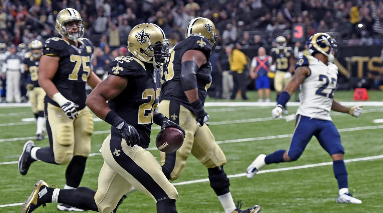 New Orleans Saints running back Mark Ingram (22) crosses the goal line on a touchdown carry in the second half of an NFL football game against the Los Angeles Rams in New Orleans, Sunday, Nov. 27, 2016. (AP Photo/Bill Feig)