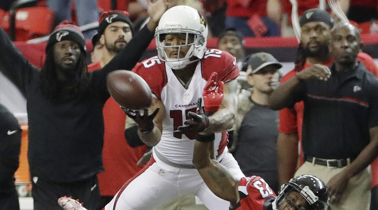 Arizona Cardinals wide receiver Michael Floyd (15) misses the catch against Atlanta Falcons cornerback Robert Alford (23) during the second of an NFL football game, Sunday, Nov. 27, 2016, in Atlanta. (AP Photo/David Goldman)