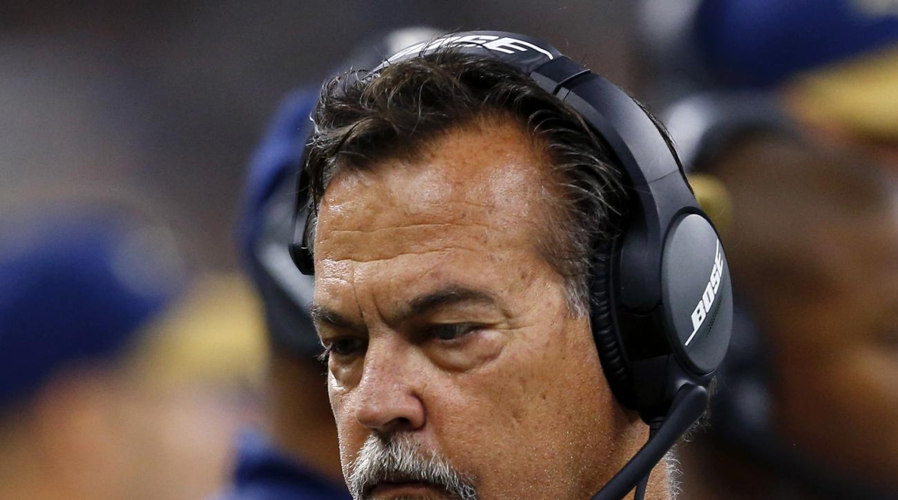 Los Angeles Rams head coach Jeff Fisher reacts on the sideline in the first half of an NFL football game against the New Orleans Saints in New Orleans, Sunday, Nov. 27, 2016. (AP Photo/Butch Dill)