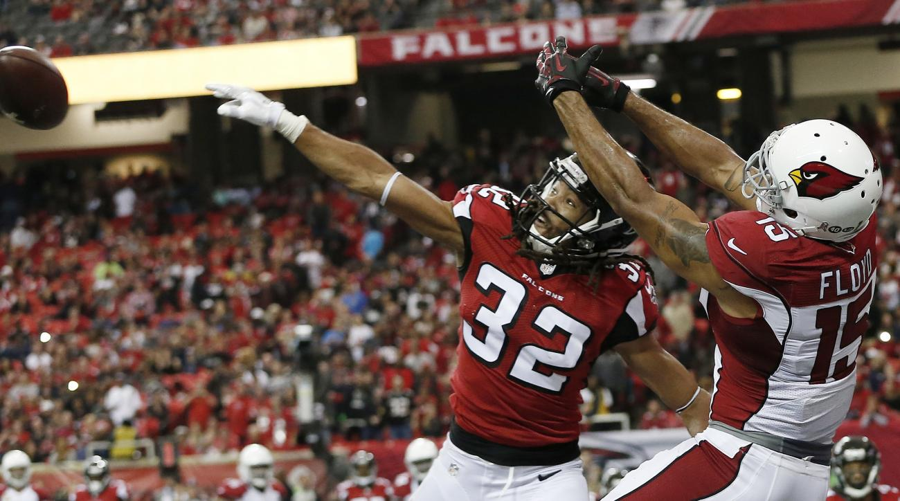 Atlanta Falcons cornerback Jalen Collins (32) breaks up a pass intended for Arizona Cardinals wide receiver Michael Floyd (15) during a two-point conversion during the second of an NFL football game, Sunday, Nov. 27, 2016, in Atlanta. (AP Photo/John Bazem