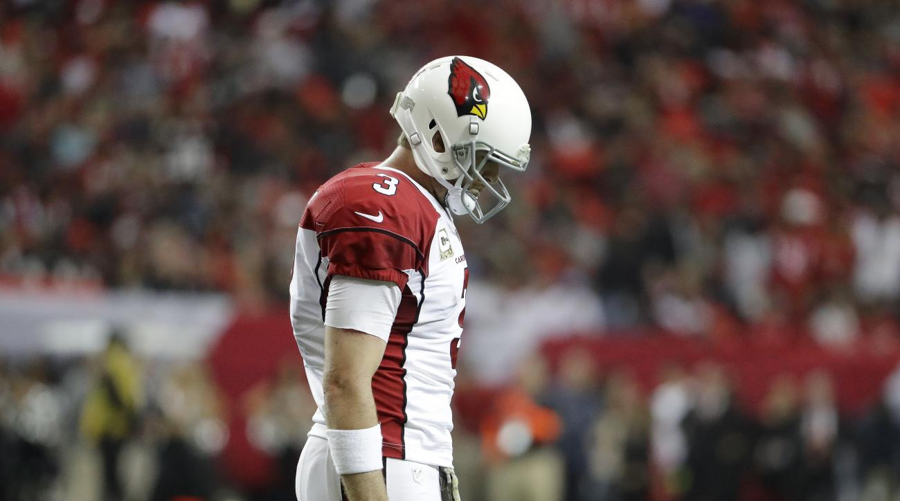 Arizona Cardinals quarterback Carson Palmer (3) walks off the field after the Cardinals missed a two-point conversion against the Atlanta Falcons during the second of an NFL football game, Sunday, Nov. 27, 2016, in Atlanta. (AP Photo/David Goldman)