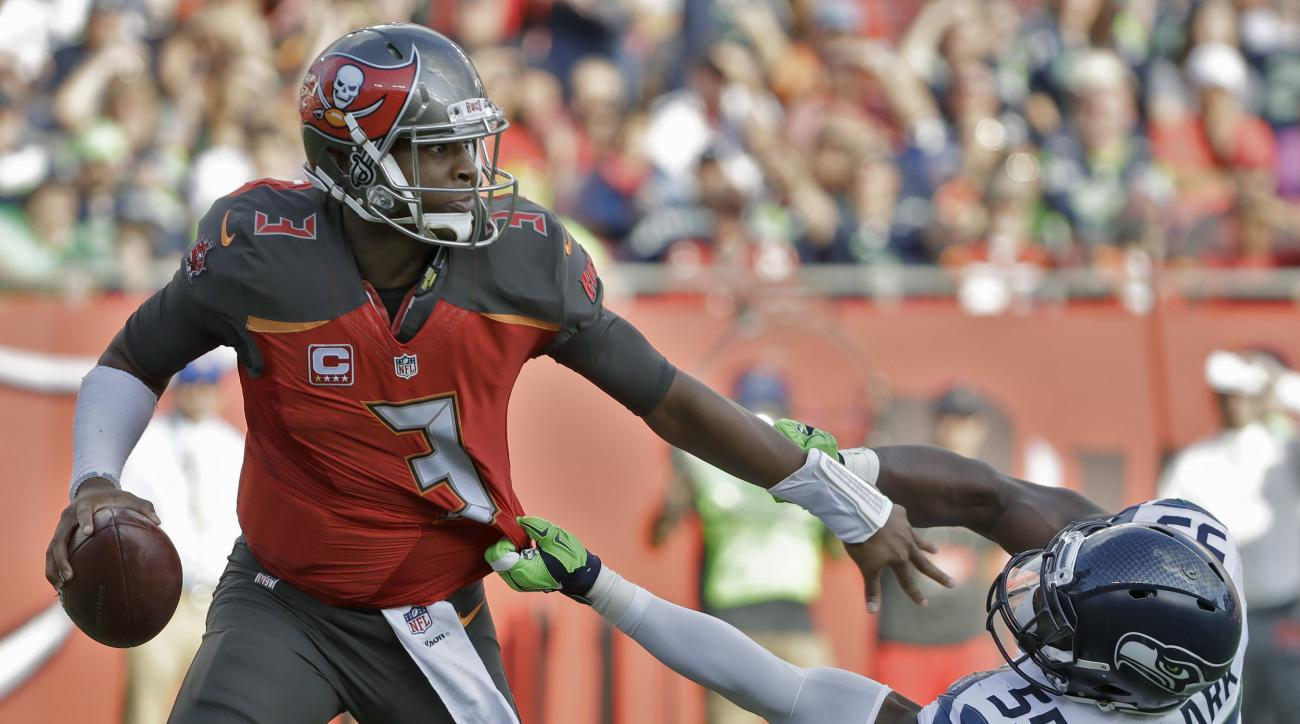 Tampa Bay Buccaneers quarterback Jameis Winston (3) pushes off Seattle Seahawks defensive end Frank Clark (55) during the first quarter of an NFL football game Sunday, Nov. 27, 2016, in Tampa, Fla. (AP Photo/Chris O'Meara)