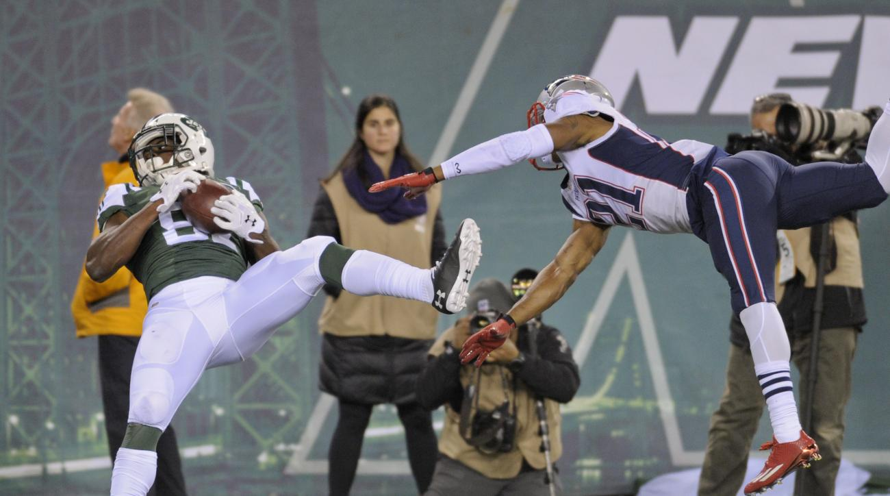 New York Jets wide receiver Quincy Enunwa (81) makes a touchdown catch against New England Patriots cornerback Malcolm Butler (21) during the fourth quarter of an NFL football game, Sunday, Nov. 27, 2016, in East Rutherford, N.J. (AP Photo/Bill Kostroun)