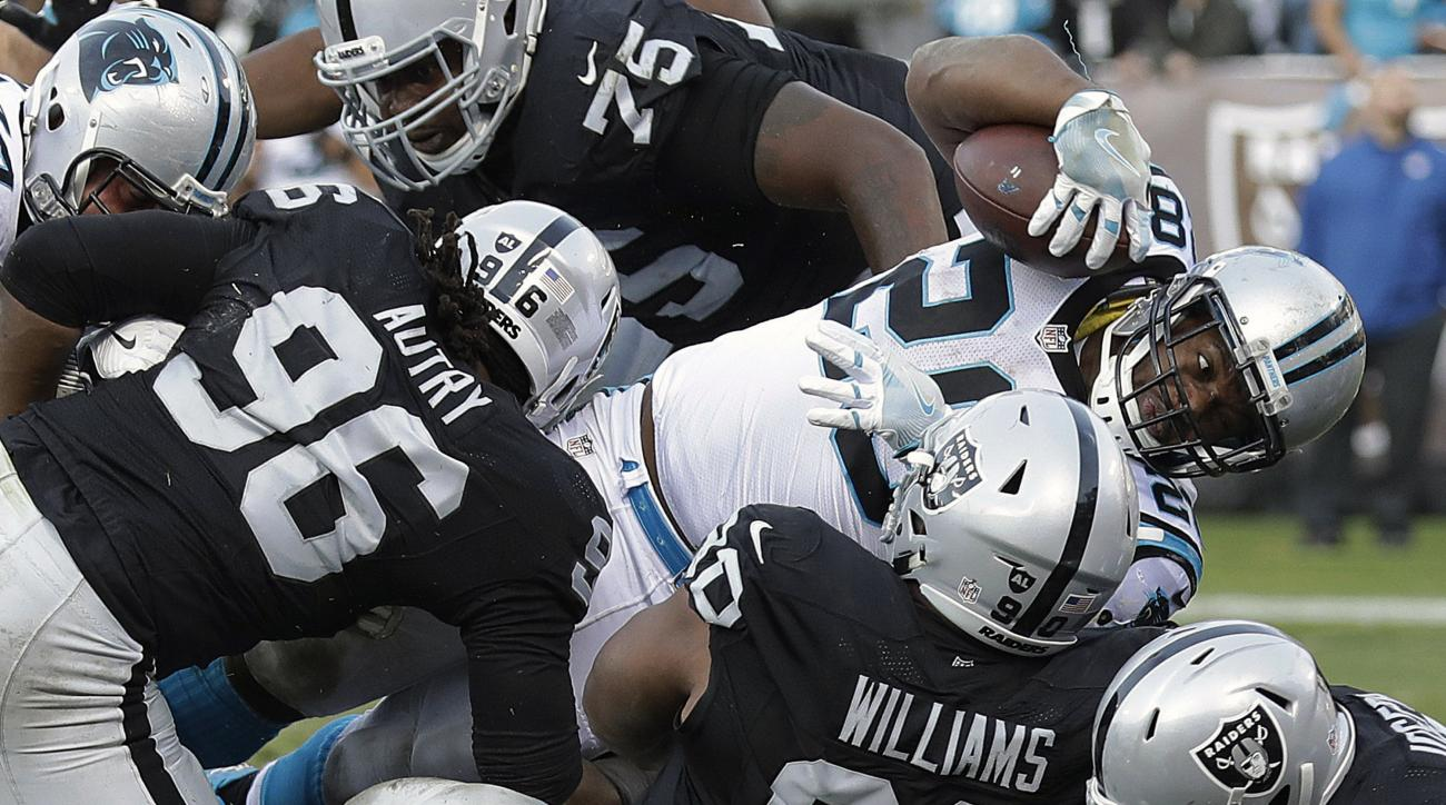 Carolina Panthers running back Jonathan Stewart (28) scores a touchdown against the Oakland Raiders during the second half of an NFL football game in Oakland, Calif., Sunday, Nov. 27, 2016. (AP Photo/Marcio Jose Sanchez)