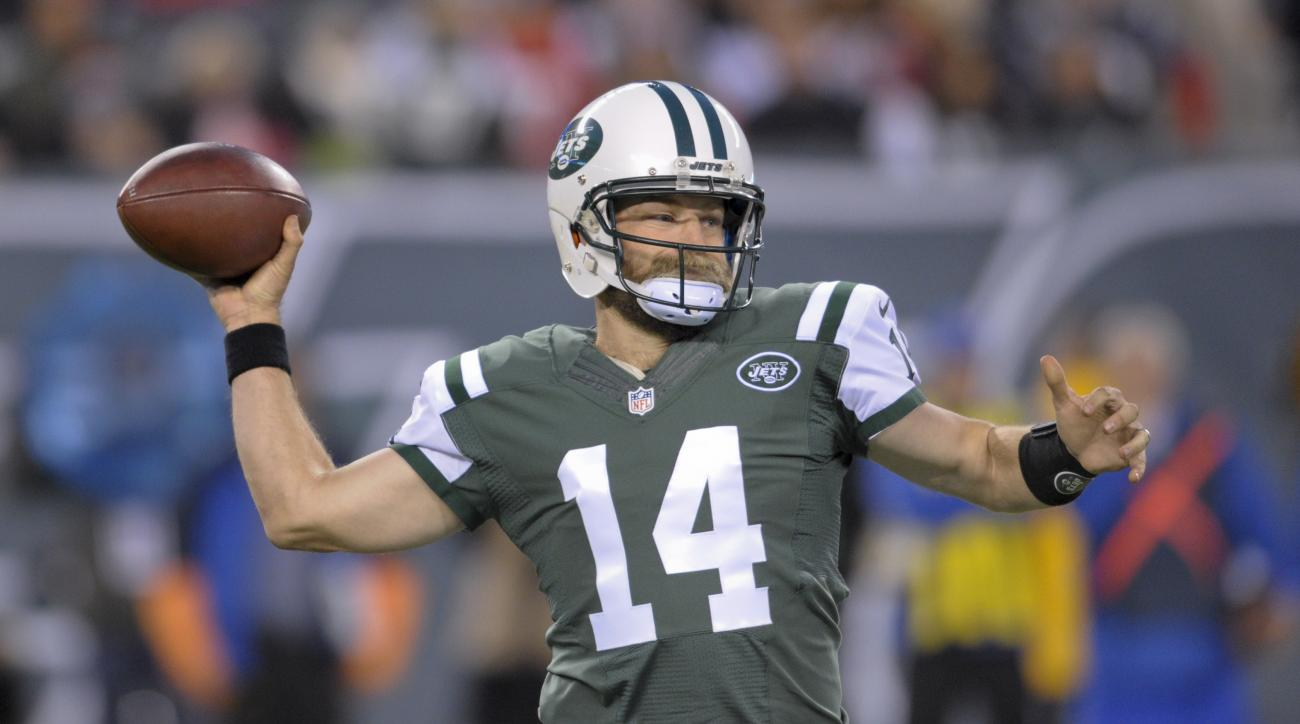 New York Jets quarterback Ryan Fitzpatrick (14) throws against the New England Patriots during the first quarter of an NFL football game, Sunday, Nov. 27, 2016, in East Rutherford, N.J. (AP Photo/Bill Kostroun)