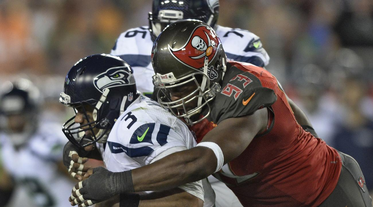 Tampa Bay Buccaneers defensive tackle Gerald McCoy (93) sacks Seattle Seahawks quarterback Russell Wilson (3) during the fourth quarter of an NFL football game Sunday, Nov. 27, 2016, in Tampa, Fla. The Buccaneers won the game 14-5. (AP Photo/Jason Behnken