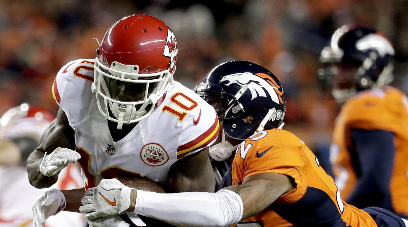 Kansas City Chiefs wide receiver Tyreek Hill (10) is tackled by Denver Broncos cornerback Chris Harris (25) during the first half of an NFL football game, Sunday, Nov. 27, 2016, in Denver. (AP Photo/Jack Dempsey)