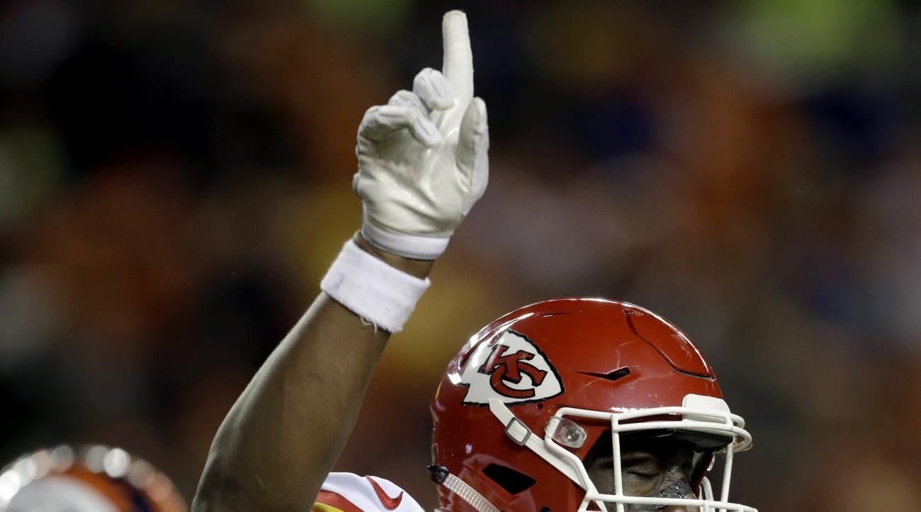 Kansas City Chiefs outside linebacker Justin Houston (50) celebrates his sack of Denver Broncos quarterback Trevor Siemian in the end zone for a safety during the first half of an NFL football game, Sunday, Nov. 27, 2016, in Denver. (AP Photo/Joe Mahoney)