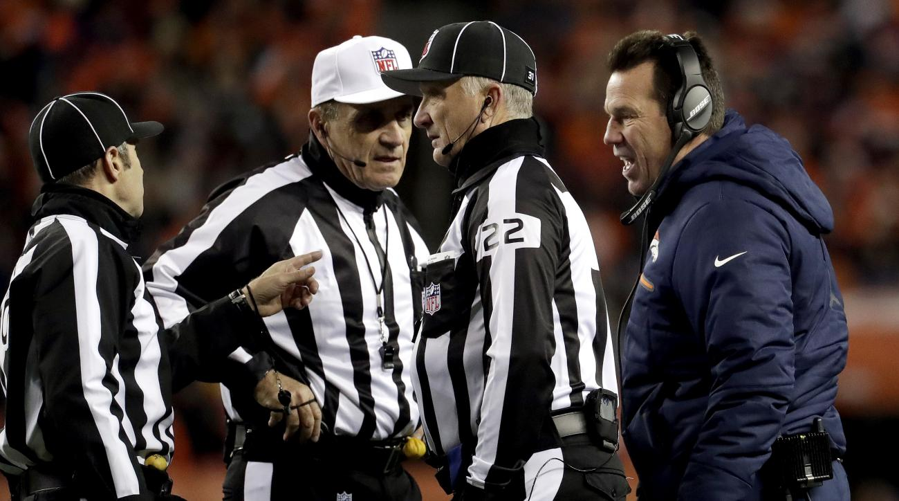 Denver Broncos head coach Gary Kubiak talks with the referees after a penalty against the Broncos led to a first down for the Kansas City Chiefs during the second half of an NFL football game, Sunday, Nov. 27, 2016, in Denver. (AP Photo/Jack Dempsey)