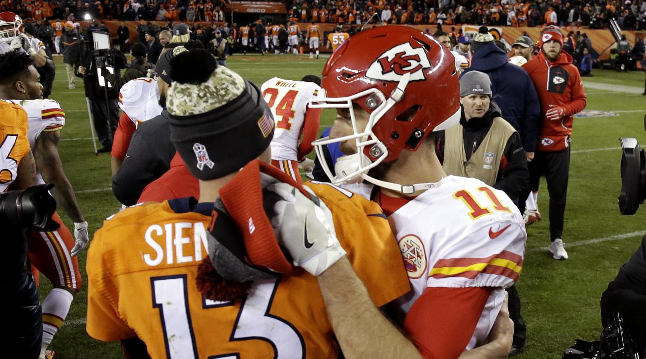 Kansas City Chiefs quarterback Alex Smith (11) and Denver Broncos quarterback Trevor Siemian (13) meet after an NFL football game against the Denver Broncos, Sunday, Nov. 27, 2016, in Denver. The Chiefs won 30-27 in overtime. (AP Photo/Jack Dempsey)