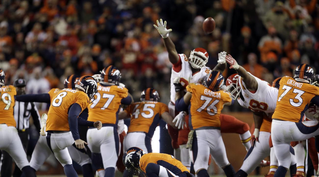 Denver Broncos kicker Brandon McManus (8) misses a 62-yard field goal attempt as Riley Dixon (9) holds during overtime of an NFL football game against the Kansas City Chiefs, Sunday, Nov. 27, 2016, in Denver. The Chiefs won 30-27 in overtime. (AP Photo/Jo
