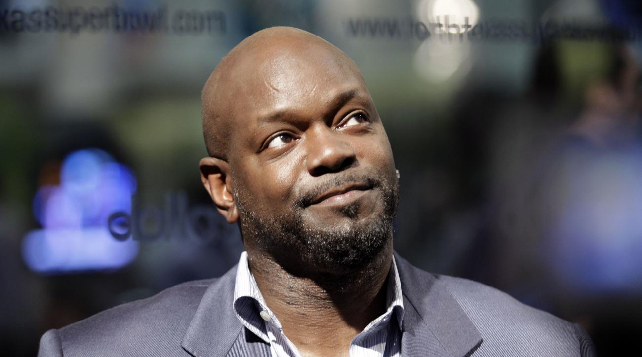 "FILE - This Feb. 3, 2010 file photo shows former Dallas Cowboys running back and contestant on ""Dancing with the Stars"" Emmitt Smith during an interview at the Super Bowl XLIV media center in Fort Lauderdale, Fla. Smith's spokeswoman said Smith's mother d"