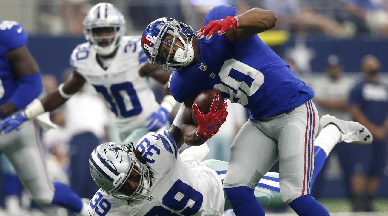 In this Sunday, Sept. 11, 2016, photo, New York Giants wide receiver Victor Cruz (80) is tackled by Dallas Cowboys cornerback Brandon Carr (39) after catching a pass during an NFL football game in Arlington, Texas. The Cowboys haven't forced a turnover in