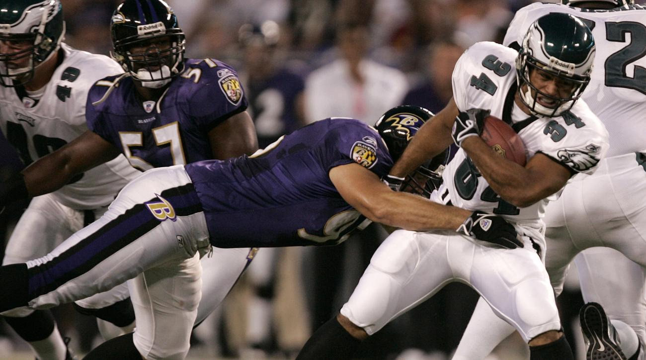 FILE - In this Aug. 17, 2006, file photo, Philadelphia Eagles running back Reno Mahe, right, pulls away from a tackle-attempt by Baltimore Ravens' Jarret Johnson during the first quarter of their pre-season football game in Baltimore. Mahe announced his 3
