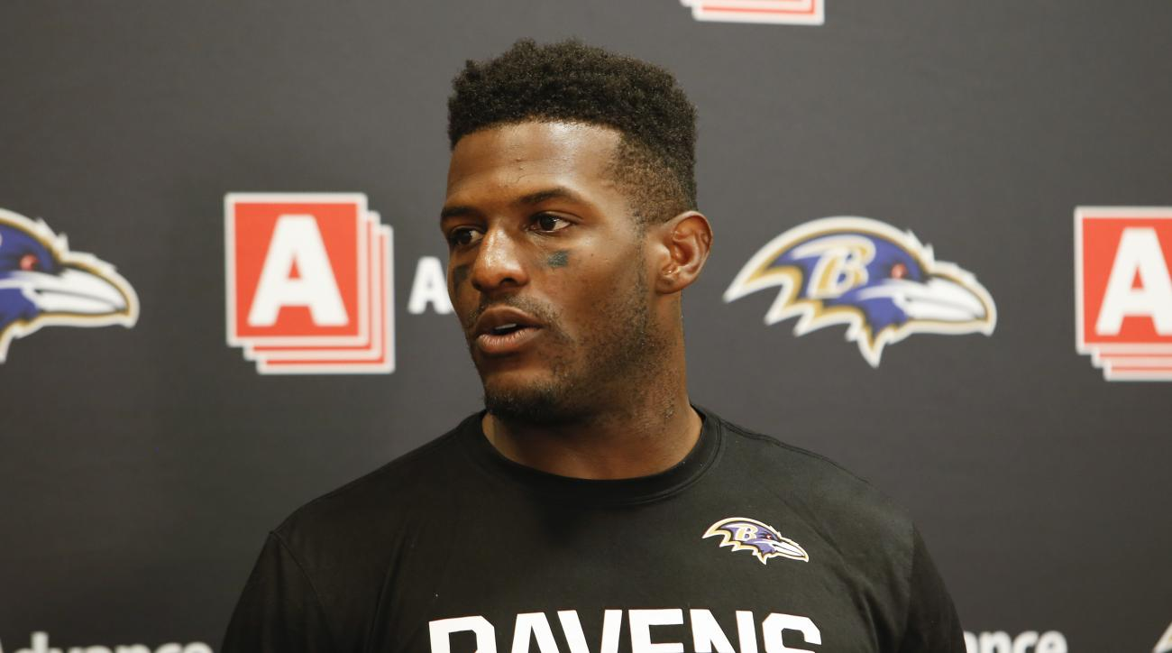 FILE - In this Sept. 18, 2016, file photo, Baltimore Ravens wide receiver Mike Wallace speaks to the media during a news conference after an NFL football game against the Cleveland Browns, in Cleveland. Wallace plays against his former team, the Miami Dol