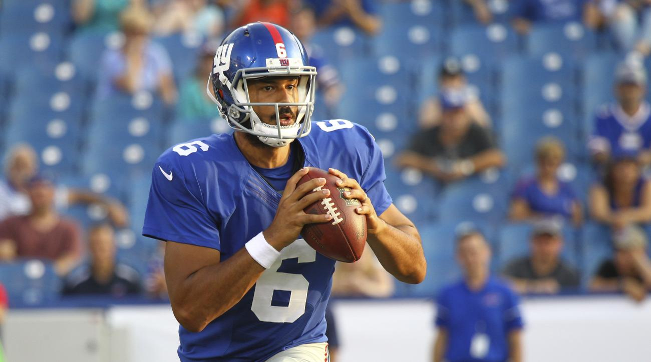 FILE - In this Aug. 20, 2016, file photo, New York Giants quarterback Logan Thomas (6) looks to pass against the Buffalo Bills during the fourth quarter of a preseason NFL football game, in Orchard Park, N.Y. The Buffalo Bills have signed Logan Thomas, a