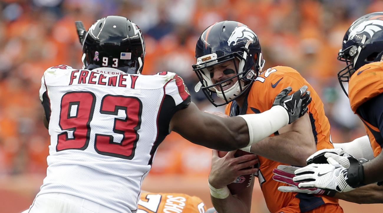 FILE - In this Oct. 9, 2016, file photo, Denver Broncos quarterback Paxton Lynch (12) is hit by Atlanta Falcons defensive end Dwight Freeney (93) during the second half of an NFL football game, in Denver. The Falcons' defense has new concerns after placin