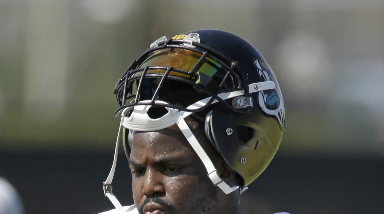 FILE -  In this Wednesday, Aug. 3, 2016 file photo, Jacksonville Jaguars defensive tackle Malik Jackson takes a break during NFL football training camp in Jacksonville, Fla. Jackson left the Super Bowl champions to sign a six-year, $85.5 million contract