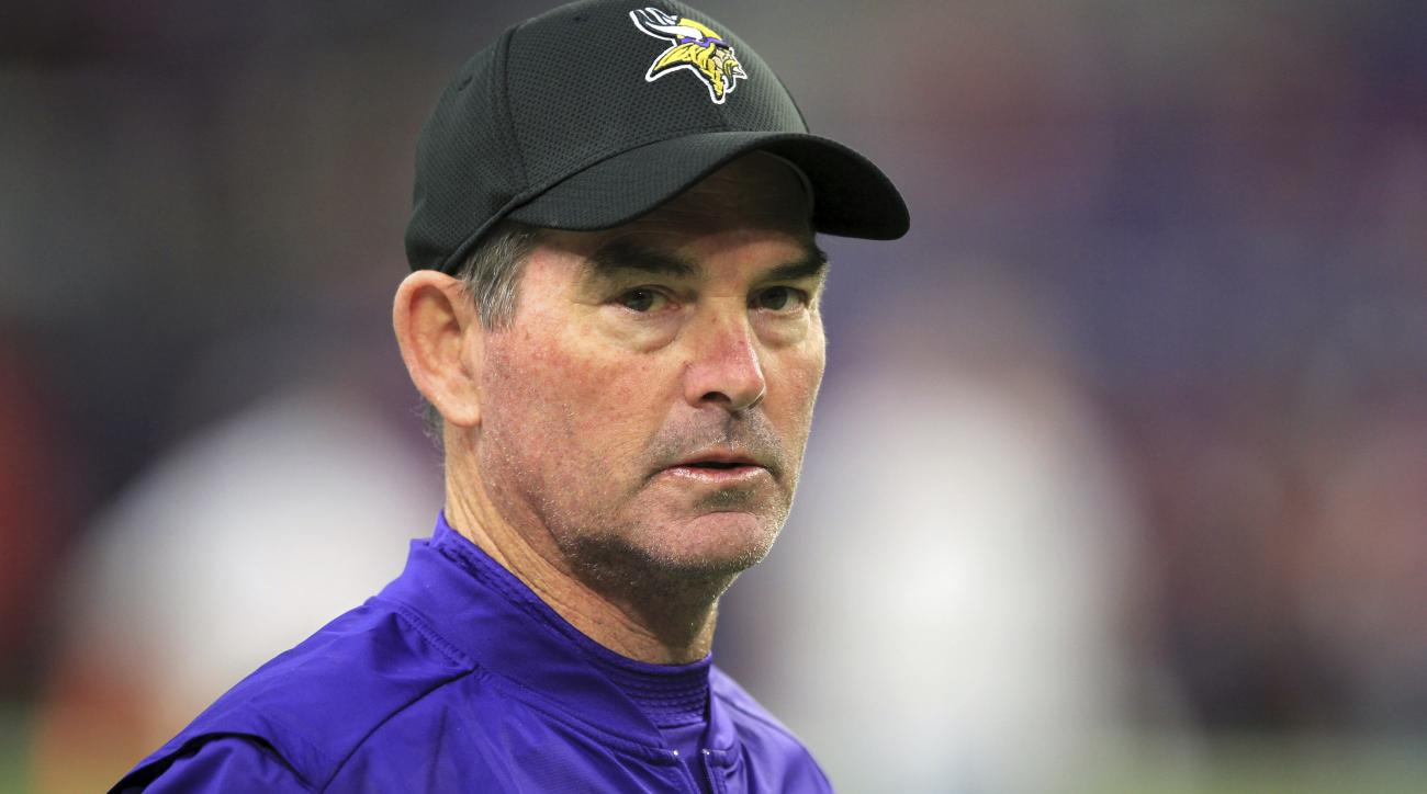 This Nov. 20, 2016 photo shows Minnesota Vikings head coach Mike Zimmer standing on the field before an NFL football game against the Arizona Cardinals in Minneapolis. Zimmer is having emergency eye surgery, about a month after he had an initial procedure
