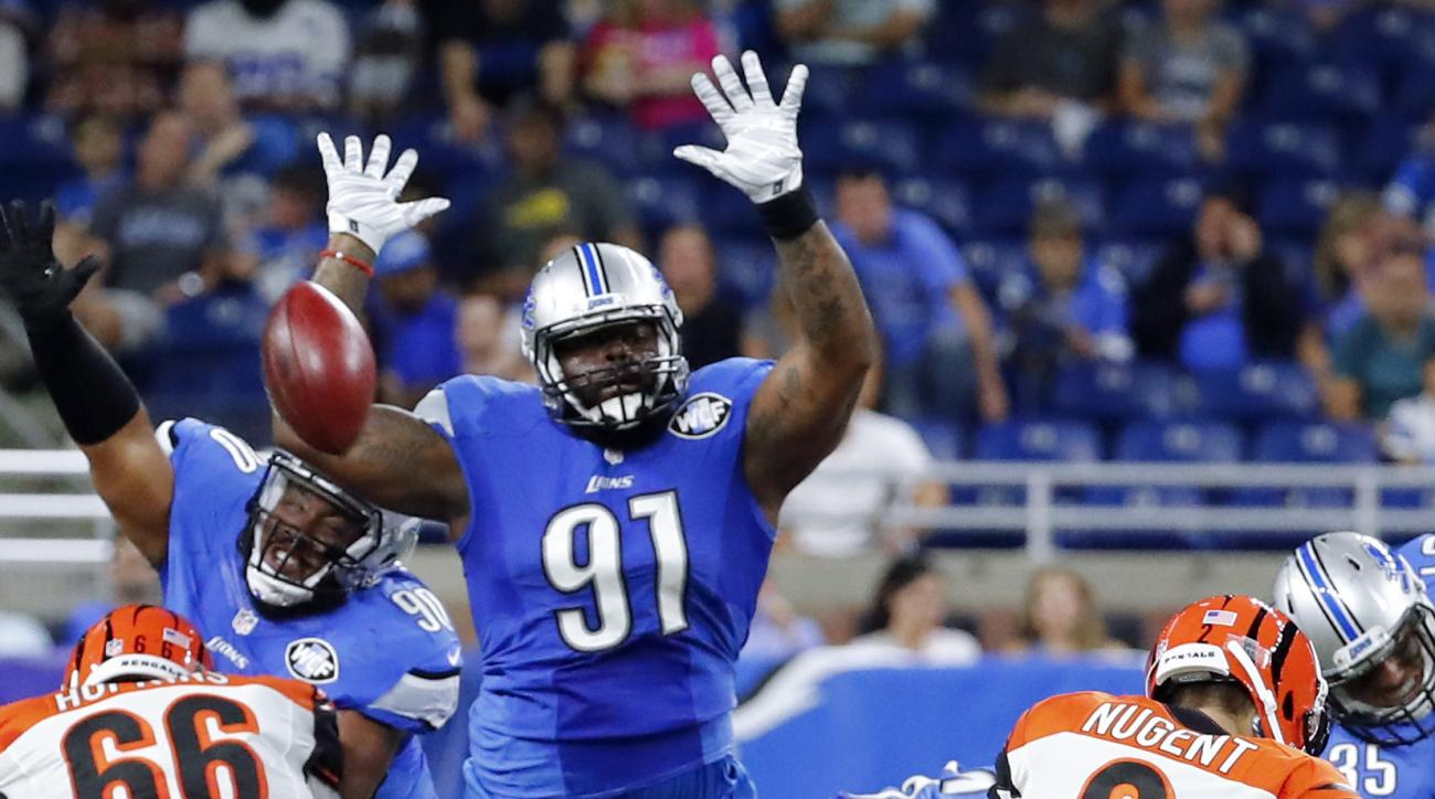 FILE - In this Aug. 18, 2016, file photo, Detroit Lions defensive tackle A'Shawn Robinson (91) jumps to try and block a Cincinnati Bengals kicker Mike Nugent (2) field goal in the second half of an NFL preseason football game in Detroit. Robinson is emerg