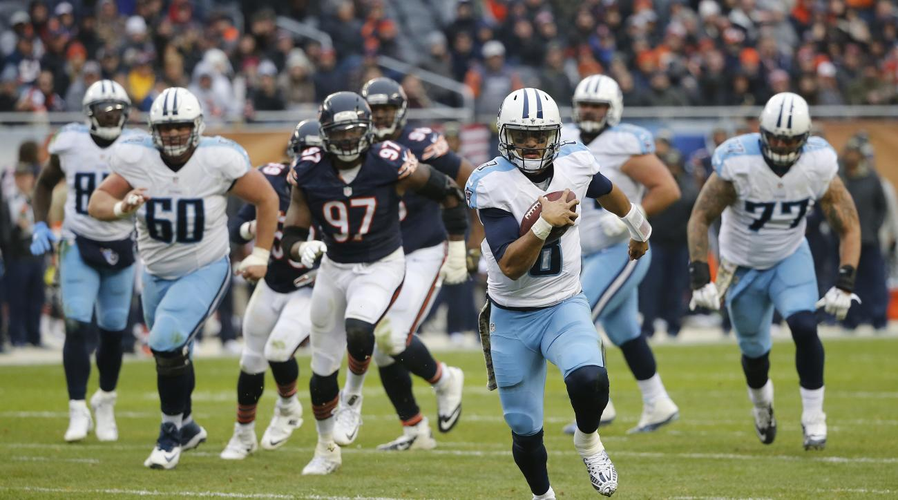 FILE - In this Nov. 27, 2016, file photo, Tennessee Titans quarterback Marcus Mariota (8) runs the ball during the second half of an NFL football game against the Chicago Bears, in Chicago. Mariota is a big reason why the Titans (6-6) sit only a half-game