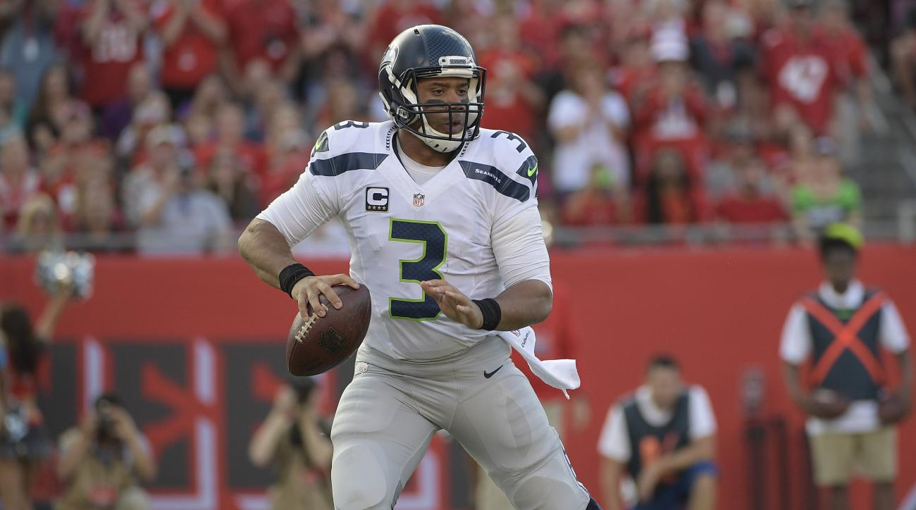 FILE - In this Sunday, Nov. 27, 2016 file photo, Seattle Seahawks quarterback Russell Wilson (3) looks to pass during the first quarter of an NFL football game against the Tampa Bay Buccaneers in Tampa, Fla. For the seventh time in five years, the Panther
