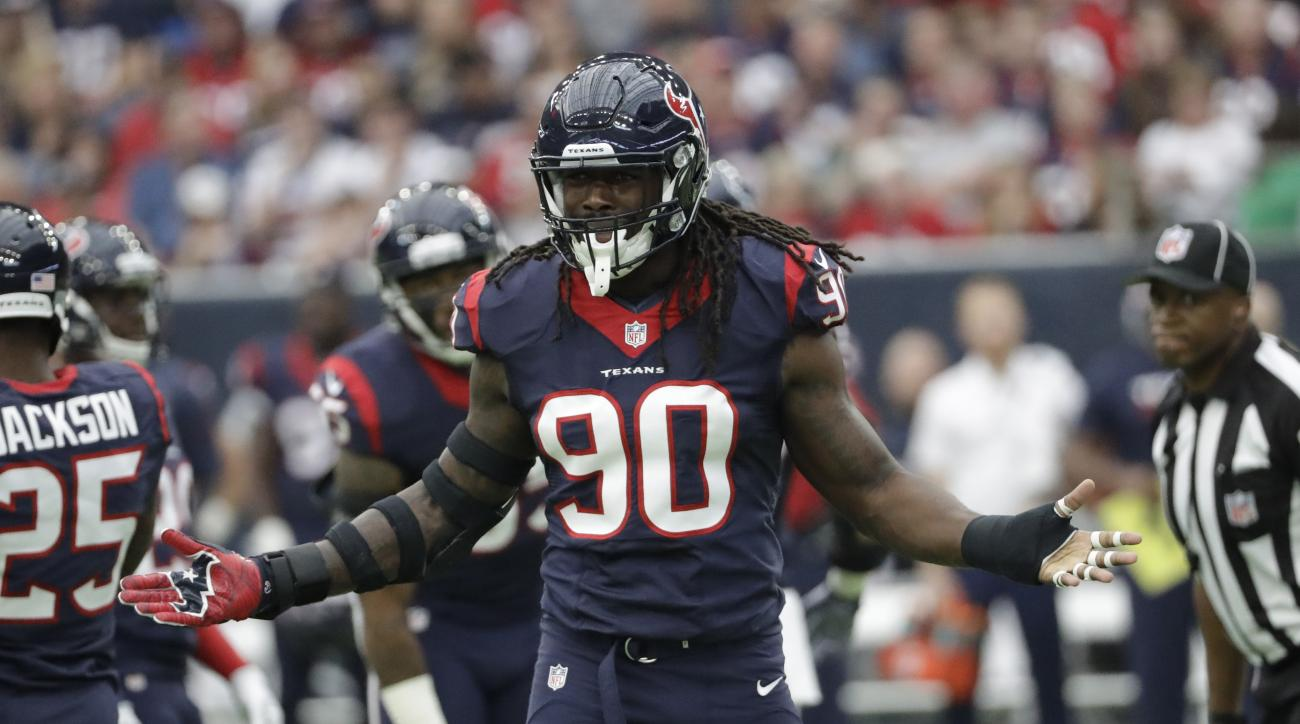 FILE - In this Nov. 27, 2016, file photo, Houston Texans' Jadeveon Clowney gestures during the team's NFL football game against the San Diego Chargers in Houston. The Texans play the Green Bay Packers and quarterback Aaron Rodgers this week. Its got to be