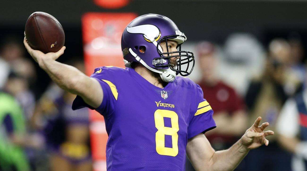 Minnesota Vikings quarterback Sam Bradford throws a pass against the Dallas Cowboys during the first half of an NFL football game Thursday, Dec. 1, 2016, in Minneapolis. (AP Photo/Jim Mone)
