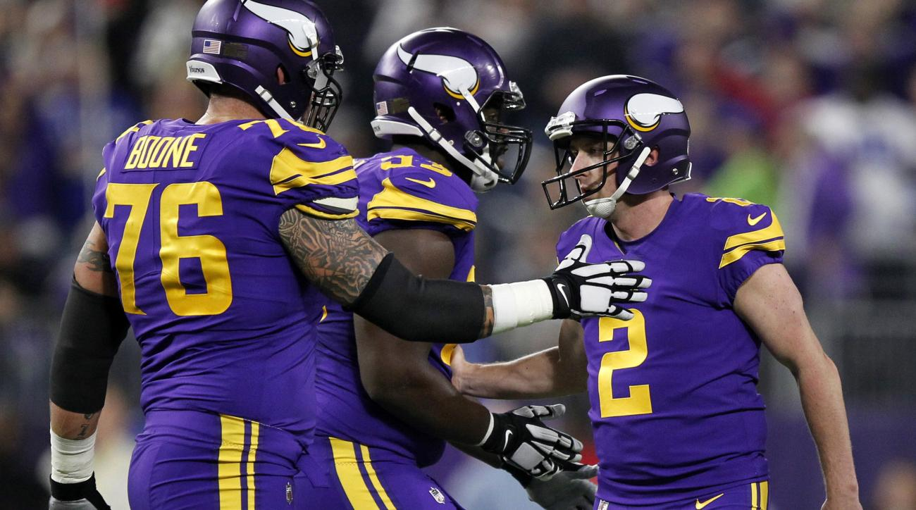 Minnesota Vikings kicker Kai Forbath (2) celebrates with teammates after making a 48-yard field goal during the first half of an NFL football game against Dallas Cowboys on Thursday, Dec. 1, 2016, in Minneapolis. (AP Photo/Andy Clayton-King)
