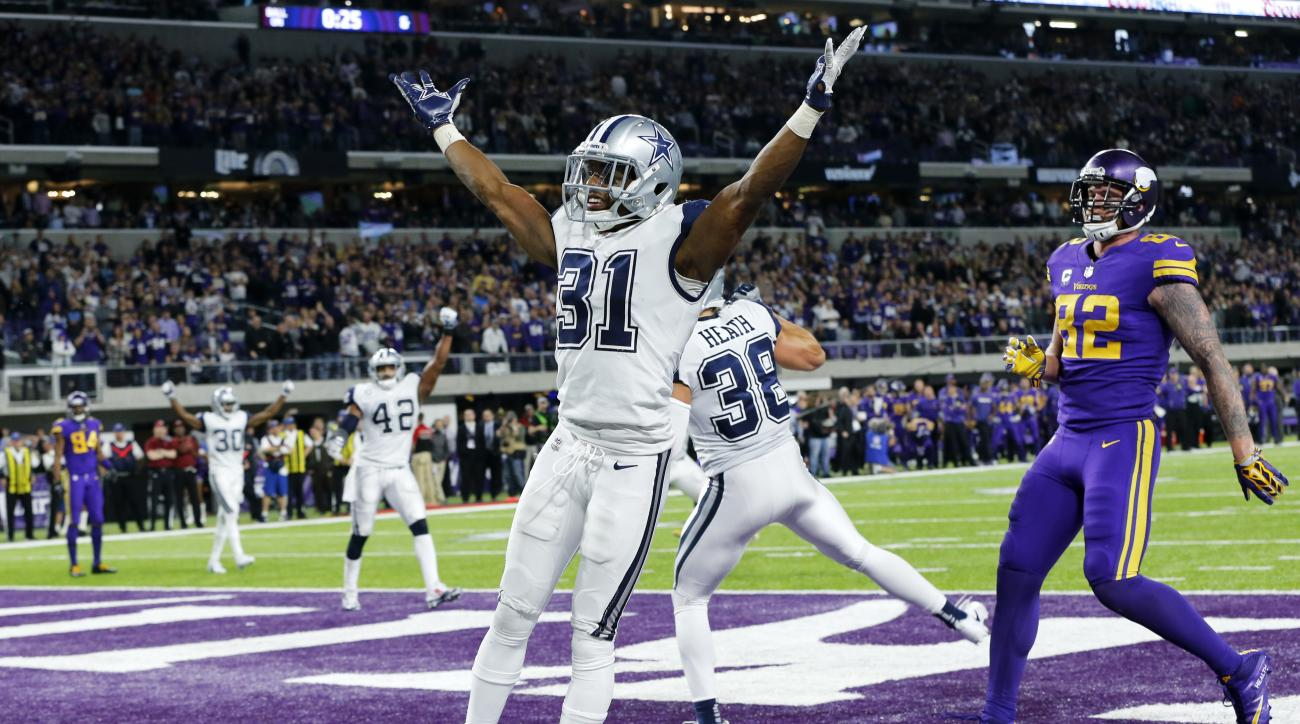 Dallas Cowboys free safety Byron Jones (31) celebrates in front of Minnesota Vikings tight end Kyle Rudolph, right, after breaking up a pass in the end zone during the second half of an NFL football game Thursday, Dec. 1, 2016, in Minneapolis. The Cowboys