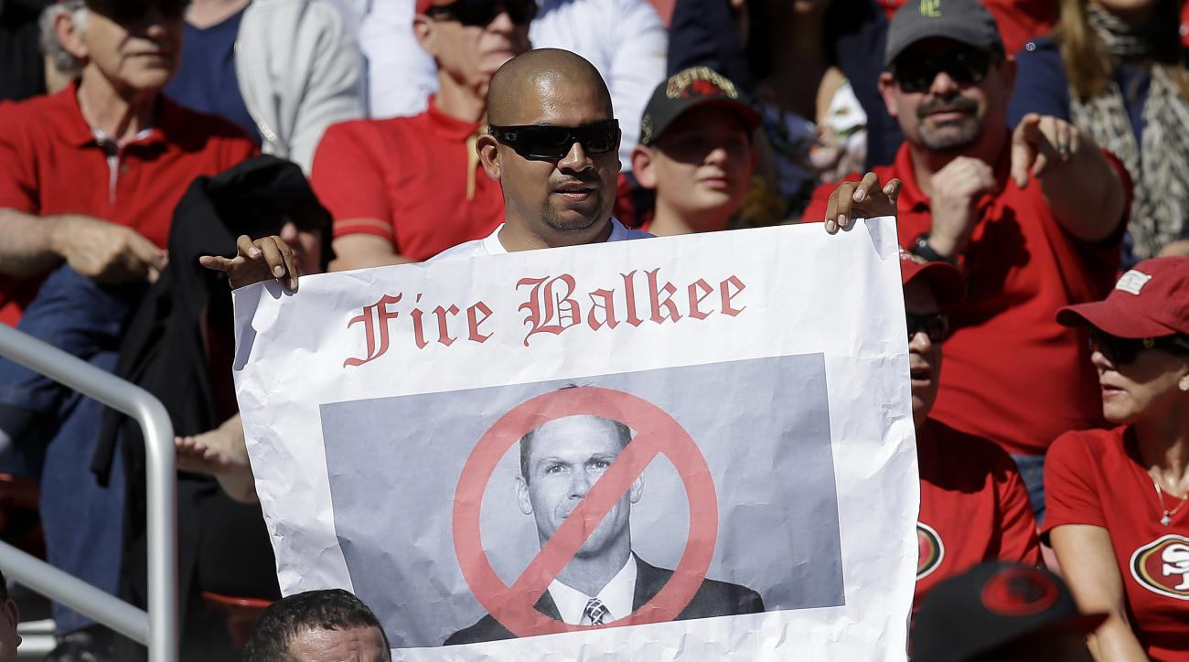 In this Oct. 23, 2016 photo, a fan holds up a sign of San Francisco 49ers general manager Trent Baalke during the first half of an NFL football game against the Tampa Bay Buccaneers in Santa Clara, Calif. The San Francisco 49ers have fallen to a new level