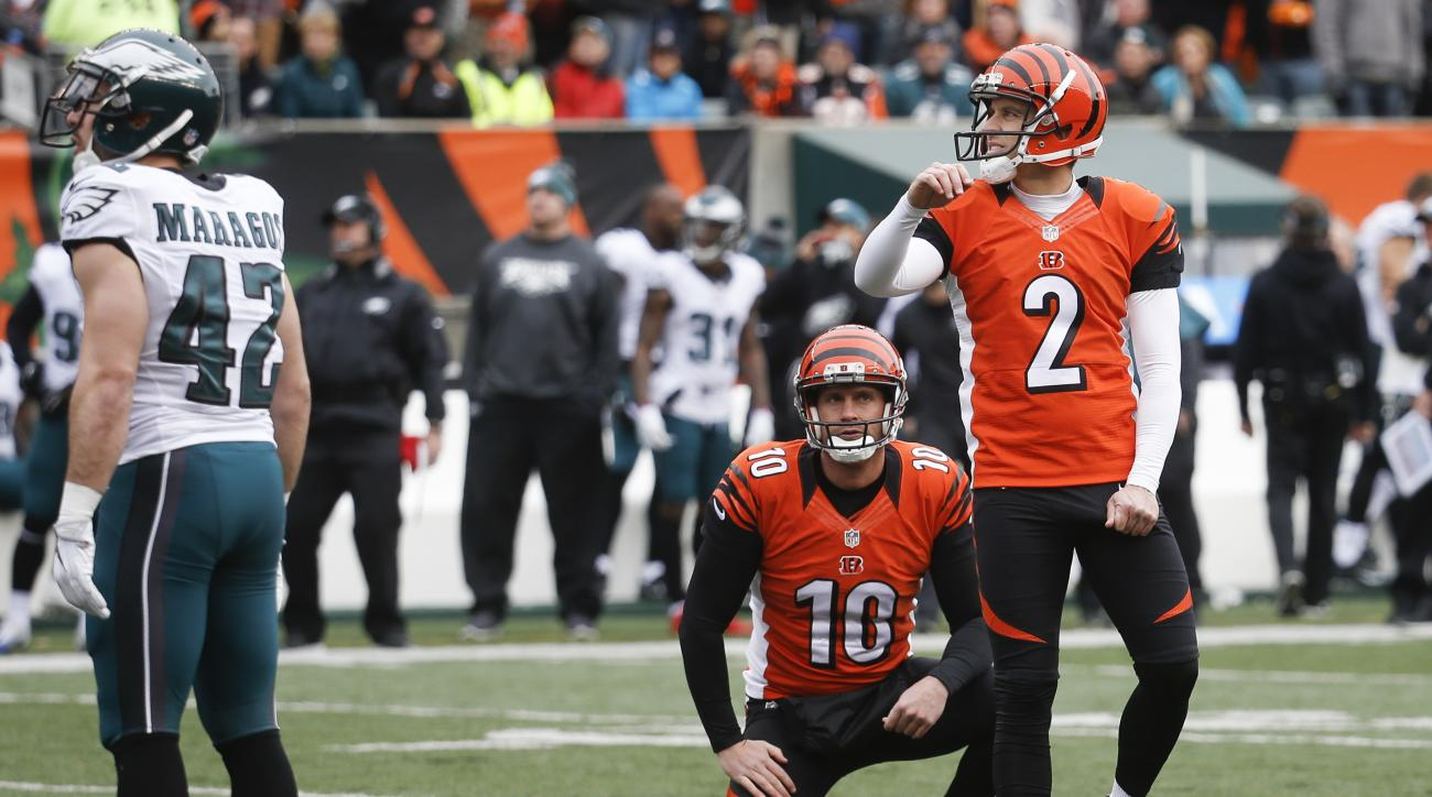 Cincinnati Bengals kicker Mike Nugent (2) watches his field goal alongside punter Kevin Huber (10) in the first half of an NFL football game against the Philadelphia Eagles, Sunday, Dec. 4, 2016, in Cincinnati. (AP Photo/Frank Victores)