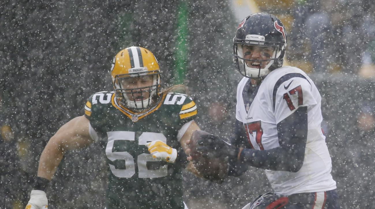 Houston Texans' Brock Osweiler scrambles to get away from Green Bay Packers' Clay Matthews (52) during the first half of an NFL football game Sunday, Dec. 4, 2016, in Green Bay, Wis. (AP Photo/Mike Roemer)