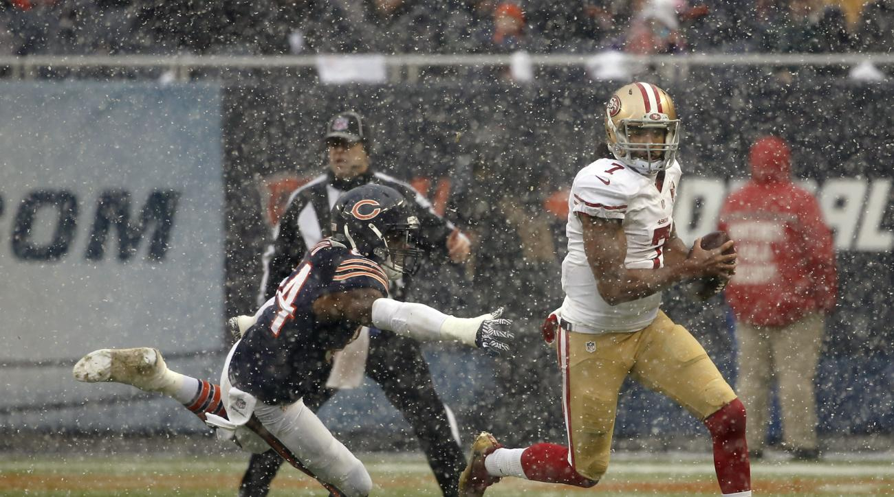 San Francisco 49ers quarterback Colin Kaepernick (7) tries to run away from Chicago Bears linebacker Leonard Floyd (94) during the first half of an NFL football game, Sunday, Dec. 4, 2016, in Chicago. (AP Photo/Charles Rex Arbogast)