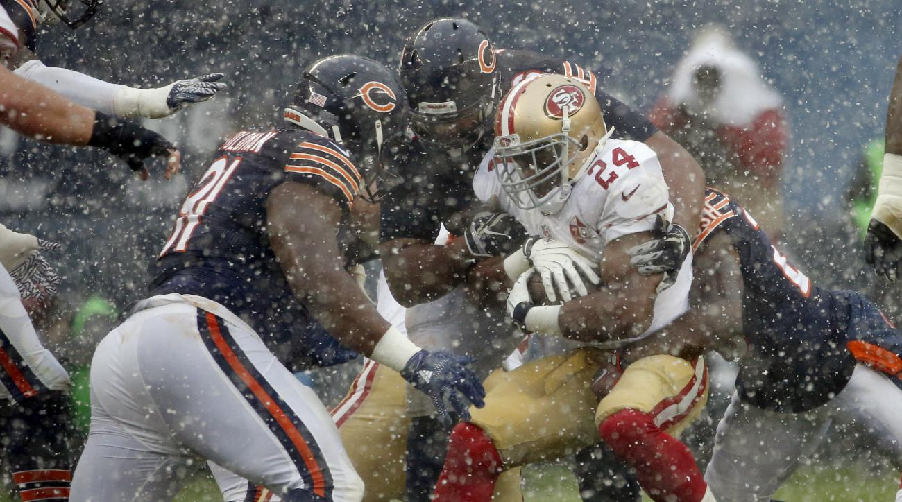 San Francisco 49ers running back Shaun Draughn (24) is tackled by Chicago Bears defenders during the first half of an NFL football game, Sunday, Dec. 4, 2016, in Chicago. (AP Photo/Nam Y. Huh)
