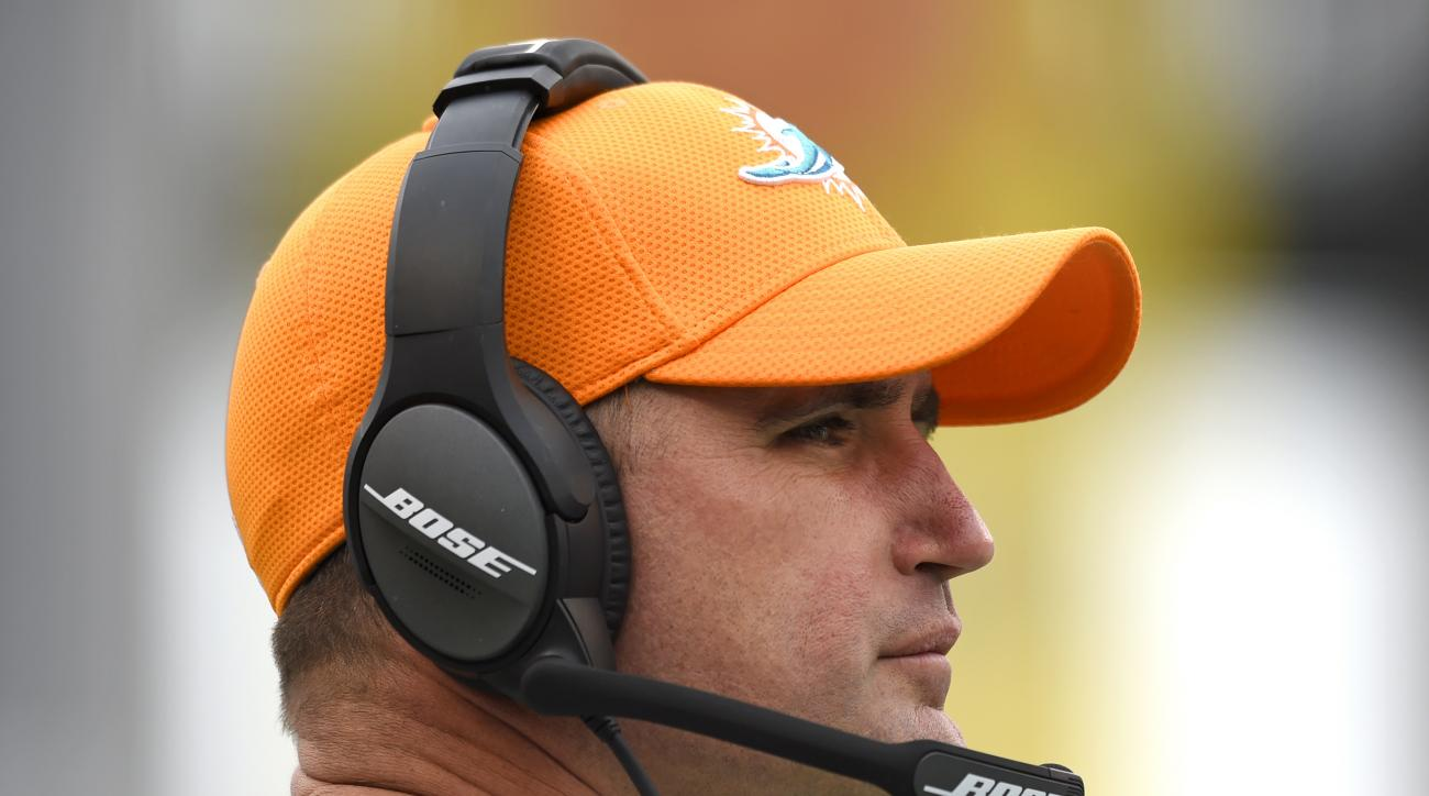 Miami Dolphins head coach Adam Gase stands on the sideline in the first half of an NFL football game against the Baltimore Ravens, Sunday, Dec. 4, 2016, in Baltimore. (AP Photo/Gail Burton)