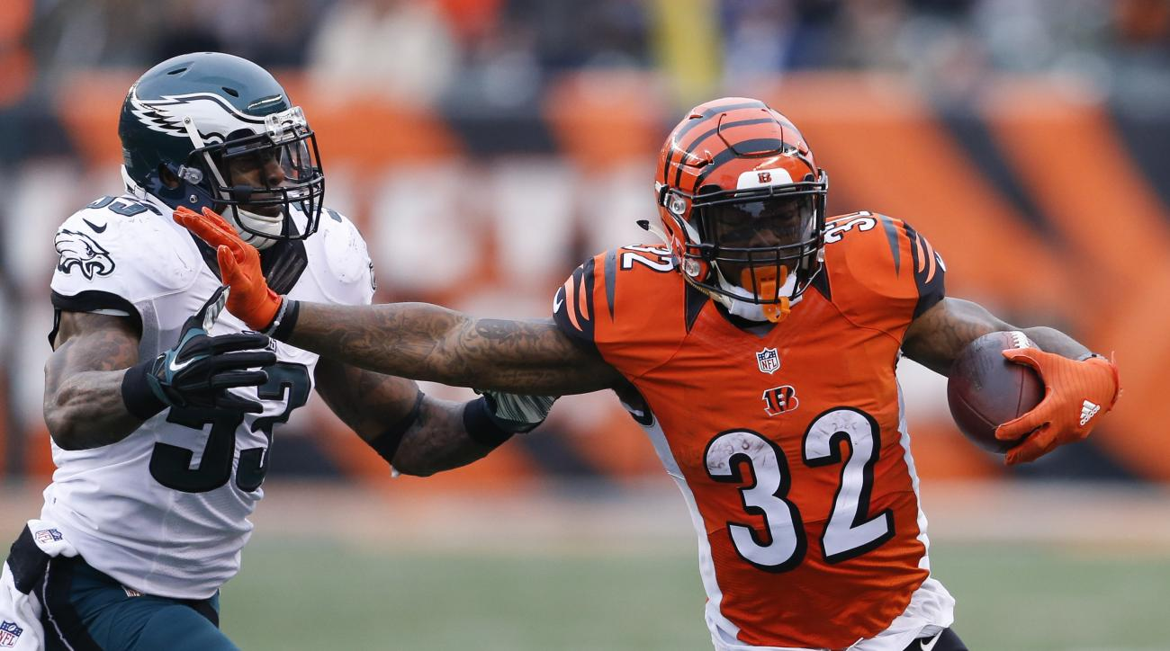 Cincinnati Bengals running back Jeremy Hill (32) runs the ball against Philadelphia Eagles outside linebacker Nigel Bradham (53) in the second half of an NFL football game, Sunday, Dec. 4, 2016, in Cincinnati. (AP Photo/Gary Landers)