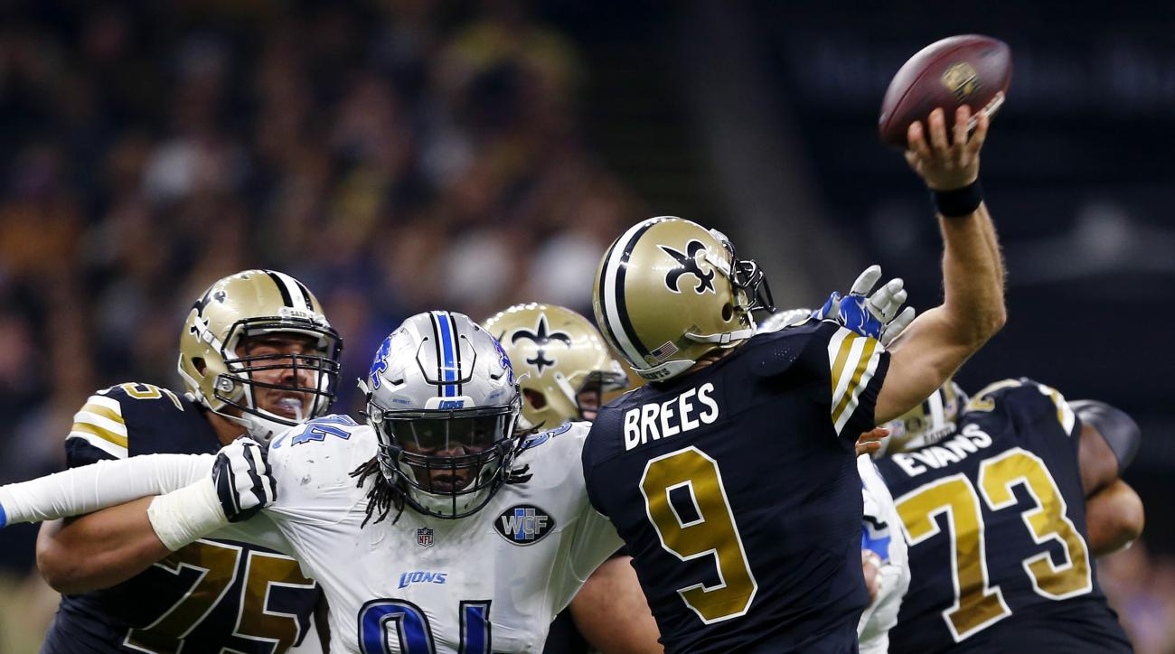 New Orleans Saints quarterback Drew Brees (9) passes under pressure from Detroit Lions defensive end Ezekiel Ansah (94) in the first half of an NFL football game in New Orleans, Sunday, Dec. 4, 2016. (AP Photo/Butch Dill)