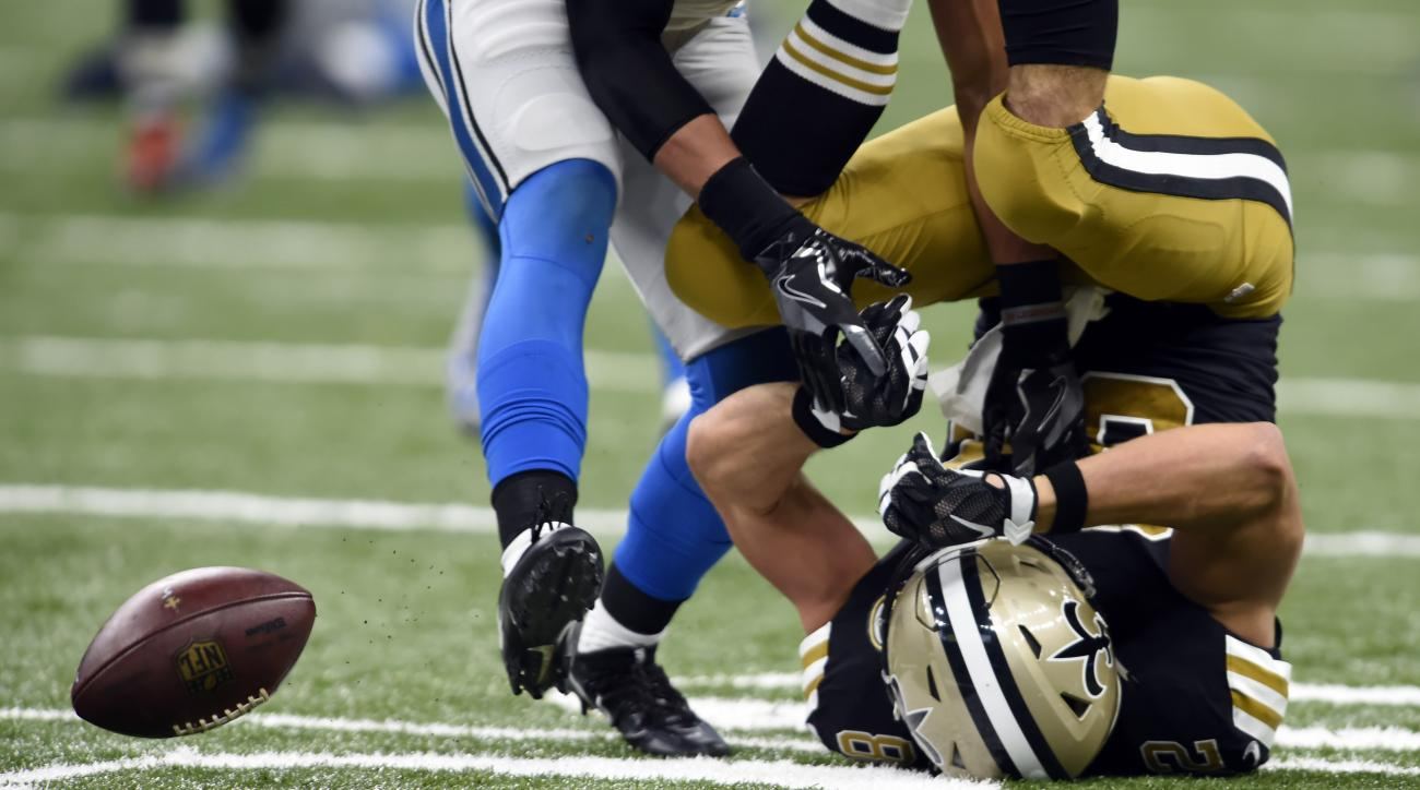 New Orleans Saints tight end Coby Fleener (82) is upended on an incompletion in the second half of an NFL football game against the Detroit Lions in New Orleans, Sunday, Dec. 4, 2016. (AP Photo/Bill Feig)