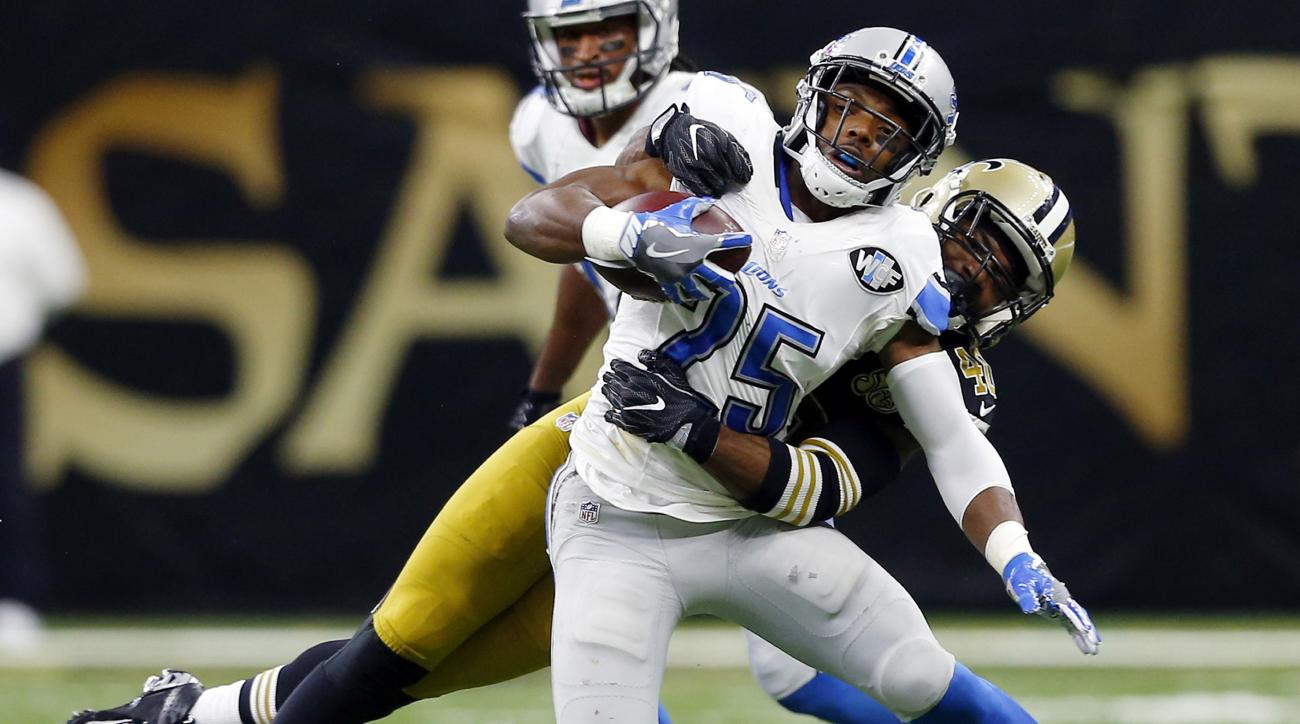 Detroit Lions running back Theo Riddick (25) is tackled by New Orleans Saints cornerback Delvin Breaux in the second half of an NFL football game in New Orleans, Sunday, Dec. 4, 2016. (AP Photo/Butch Dill)
