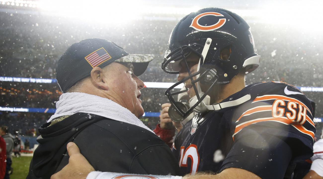 San Francisco 49ers head coach Chip Kelly, left, talks to Chicago Bears quarterback Matt Barkley (12) after their NFL football game, Sunday, Dec. 4, 2016, in Chicago. The Bears won 26-6. (AP Photo/Nam Y. Huh)