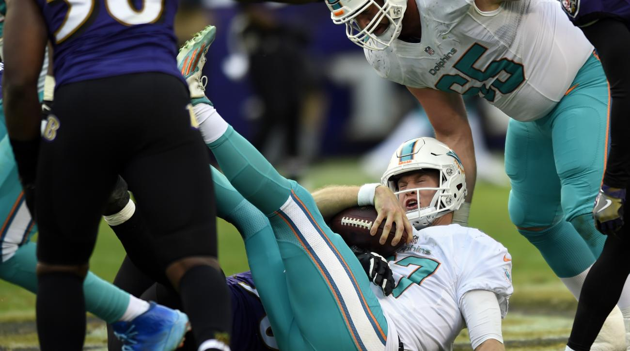 Miami Dolphins quarterback Ryan Tannehill reacts after being sacked by Baltimore Ravens defensive end Brent Urban in the second half of an NFL football game, Sunday, Dec. 4, 2016, in Baltimore. Baltimore won 38-6. (AP Photo/Gail Burton)