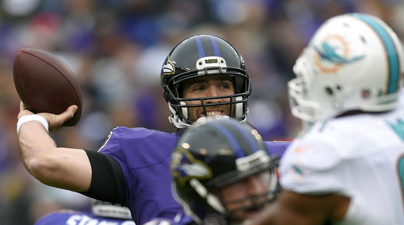 Baltimore Ravens quarterback Joe Flacco, center, throws to a receiver in the first half of an NFL football game against the Miami Dolphins, Sunday, Dec. 4, 2016, in Baltimore. (AP Photo/Nick Wass)