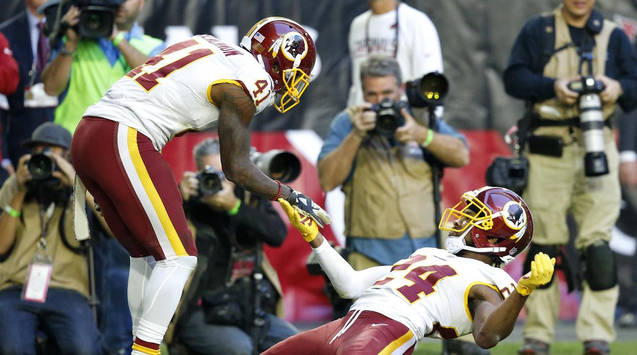 Washington Redskins cornerback Josh Norman (24) celebrates his defensive stop in the end zone with teammate free safety Will Blackmon (41) during the first half of an NFL football game against the Arizona Cardinals, Sunday, Dec. 4, 2016, in Glendale, Ariz