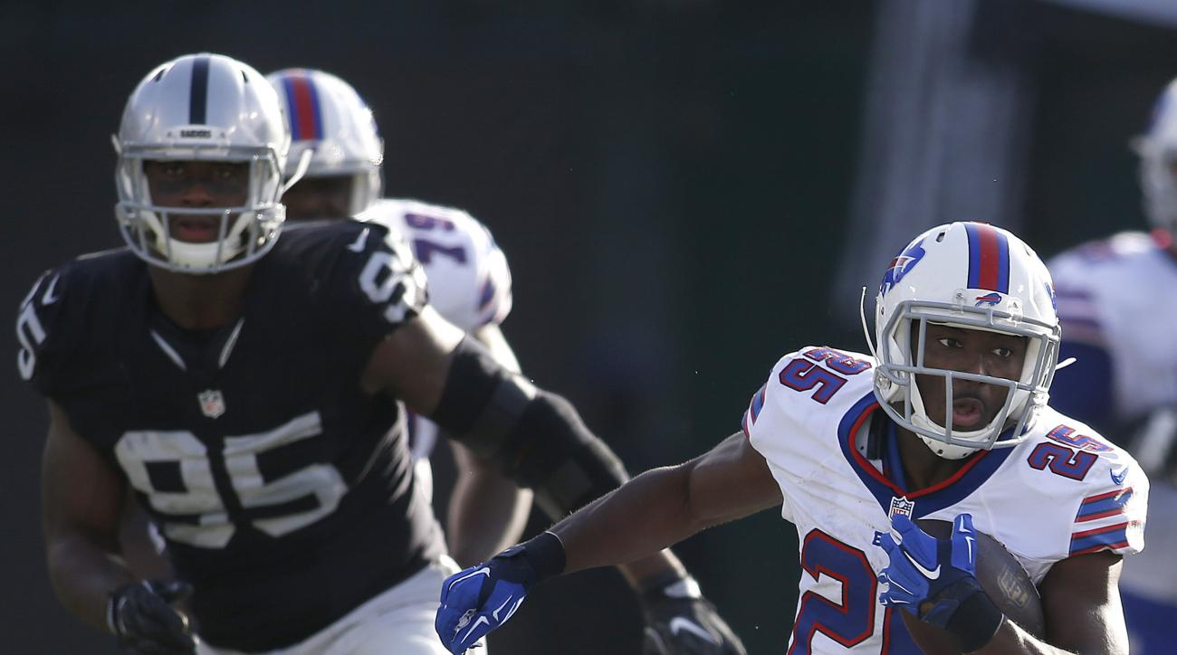 Buffalo Bills running back LeSean McCoy (25) runs in front of Oakland Raiders defensive end Jihad Ward (95) during the second half of an NFL football game in Oakland, Calif., Sunday, Dec. 4, 2016. (AP Photo/D. Ross Cameron)