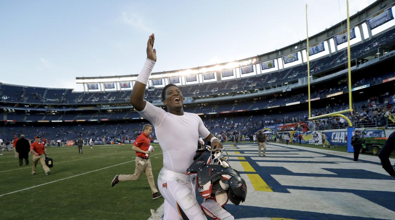 Tampa Bay Buccaneers quarterback Jameis Winston celebrates as he leaves the field after their win against the San Diego Chargers during an NFL football game Sunday, Dec. 4, 2016, in San Diego. (AP Photo/Gregory Bull)
