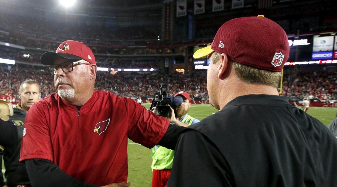 Arizona Cardinals head coach Bruce Arians greets Washington Redskins head coach Jay Gruden after an NFL football game, Sunday, Dec. 4, 2016, in Glendale, Ariz. The Cardinals won 31-23. (AP Photo/Ross D. Franklin)