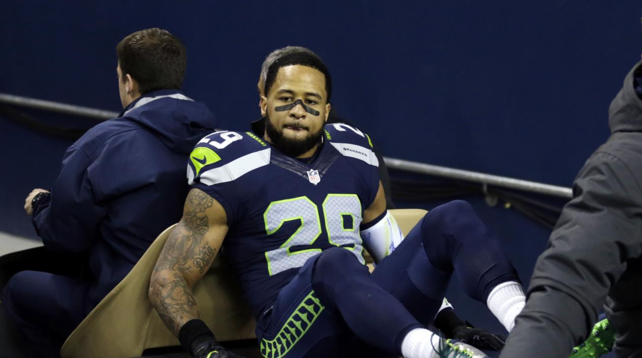 Seattle Seahawks' Earl Thomas leaves the field on a cart after being injured against the Carolina Panthers in the first half of an NFL football game, Sunday, Dec. 4, 2016, in Seattle. (AP Photo/Stephen Brashear)