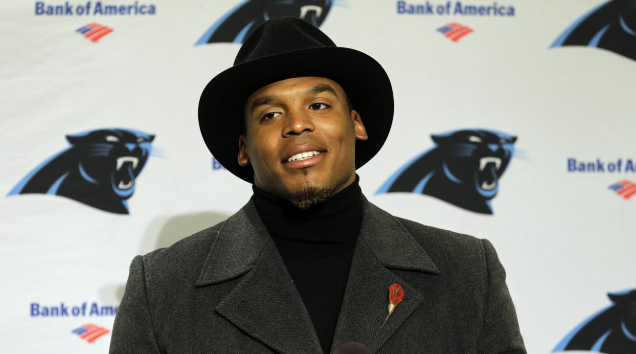 Carolina Panthers quarterback Cam Newton wears a black coat and hat as he talks with reporters during a post-game news conference after an NFL football game against the Seattle Seahawks, Sunday, Dec. 4, 2016, in Seattle. The Seahawks won 40-7. (AP Photo/S